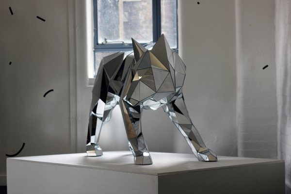 Wolf arran gregory s faceted mirrored sculptures evolo