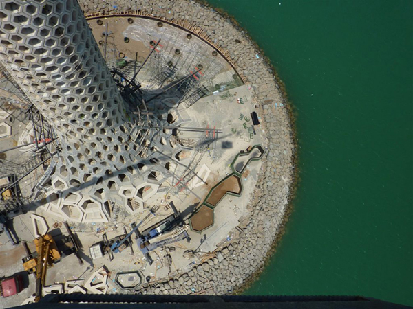 KAUST Breakwater Beacon, King Abdullah University of Science and Technology, Jeddah, honey-com façade, passive strategies, natural cooling tower, pre-cast concrete, hexagonal sections, sustainable design
